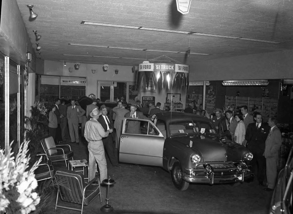 Crowd in Wilson Motor Co. showroom __ John Hensel Photograph Collection