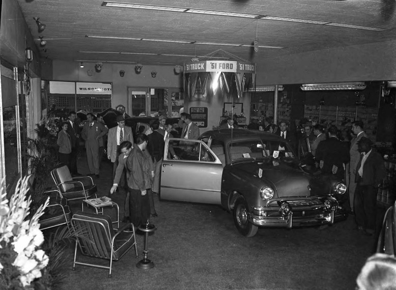 Crowd in Wilson Motor Co. showroom __ John Hensel Photograph Collection-1