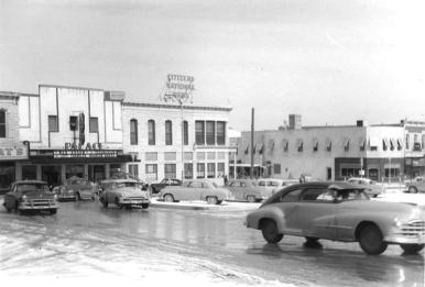 Downtown Weatherford, 1954-1955. The movie that's being shown is called 'War Arrow' and stars Maureen O'Hara